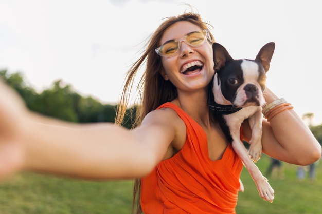 happy-pretty-woman-park-making-selfie-photo-holding-boston-terrier-dog-smiling-positive-mood-trendy-summer-style-wearing-orange-dress-sunglasses-playing-with-pet-having-fun_285396-5152